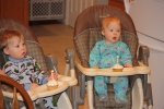 The twins are not overly impressed with the low key party and 1st birthday cupcakes