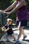 Theodore helps mom push the stroller in Acadia National Park