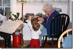 Theodore tries to point out a couple of things to Grammy while she sews