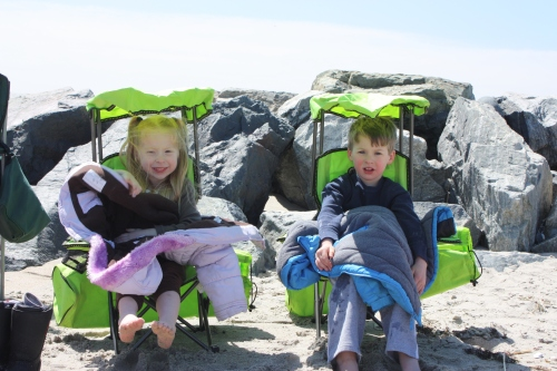 The twins grabbed some shade in their special twin chairs