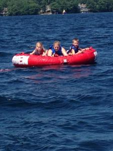 Mare and the twins enjoying some tubing on Winnipesaukee