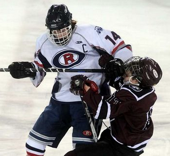 Oyster River's Grif Snow-Warbuton, left, hits Goffstown's Sebastian Beal at mid-ice during the third period of their game at the Whittemore Center in Durham Monday. Oyster River won 2-1. (Mark Bolton/Union Leader) - See more at: http://www.unionleader.com/article/20160119/SPORTS21/160119009/1003/sports#sthash.8PBs8k8Y.dpuf