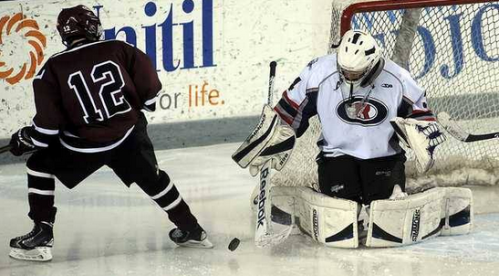 Oyster River goalie Liam McNamara makes a save on Goffstown's Michael Fortin during the third period of their game at the Whittemore Center in Durham Monday. Oyster River won, 2-1. (Mark Bolton/Union Leader) - See more at: http://www.unionleader.com/article/20160119/SPORTS21/160119009/1003/sports#sthash.8PBs8k8Y.dpuf