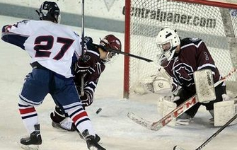 Goffstown goalie Colin Holt makes a stick save off a shot by Oyster River's Ethan Keslar (27) as Goffstown defenseman Bretton Lassonde shields Keslar from the rebound during the first period of their game at the Whittemore Center in Durham Monday. (Mark Bolton/Union Leader) - See more at: http://www.unionleader.com/article/20160119/SPORTS21/160119009/1003/sports#sthash.8PBs8k8Y.dpuf