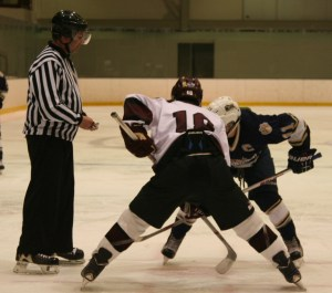 Noah Charron digs in for a faceoff against Windham. (c) 1inawesomewonder. (Photo by Charron)