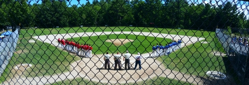 Lamprey River and Somersworth line up during the National Anthem. Babe Ruth (13-15) State Championship. Allard Park, Goffstown, NH. 07192016. (C) 1inawesomewonder.