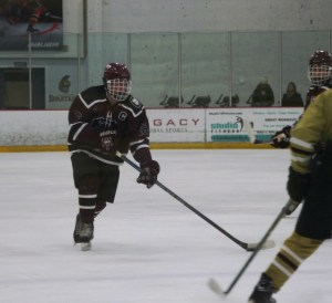 GHS 16 - Nick Nault with the puck on his stick against Portsmouth. (Photo by Charron)