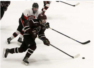 Nick Nault carries the puck versus Bedford in the Monarchs Christmas Classic Tournament.