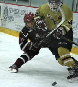 GHS 12 - Maggie Fifield battles for the puck against Portsmouth. (Photo by Charron)